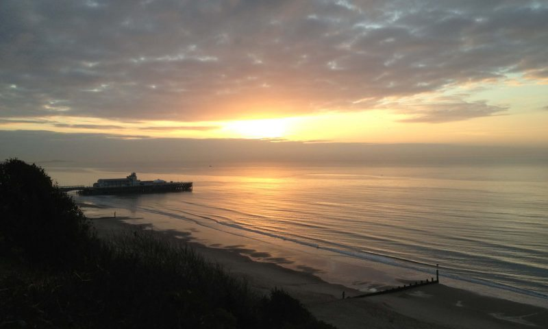 View of Bournemouth Pier from West Cliff at Sunset - TravelRest Hotels